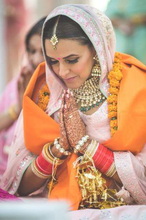 Actor Neha Dhupia at her anand karaj in a light pink lehenga
