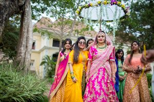 Bridal entry with bridesmaids and floral umbrella