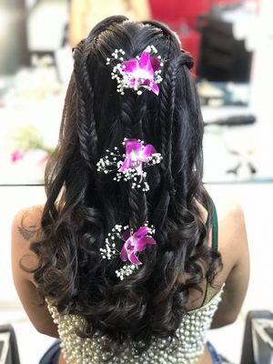 Braided hairdo with orchids in hair