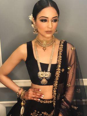 Stunning black lehenga with smokey eyes and bridal jewellery