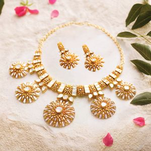 Gold and kundan necklace and earrings
