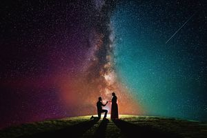 Beautiful proposal shot against a lovely sky