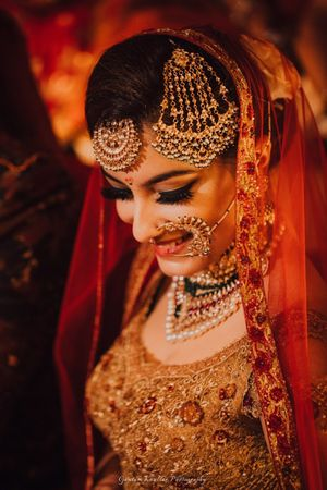 Pretty gold jhoomer for wedding