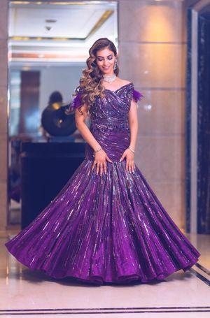 Purple mermaid gown with tassel sleeves
