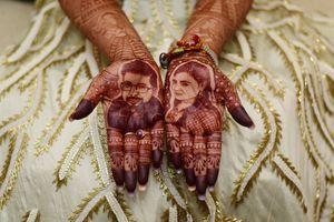 Mehendi with realistic bride and groom portraits