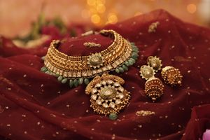 Pretty gold jewelry with bridal earrings.