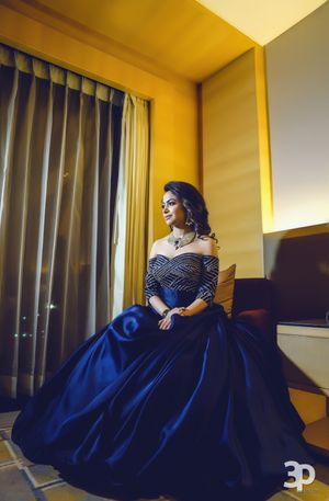 Navy blue flared off shoulder gown