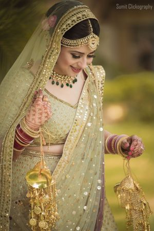 Pastel mint green and gold lehenga