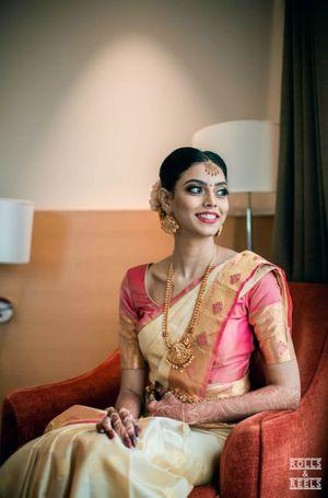 Unique gold kanjivaram saree with pink blouse