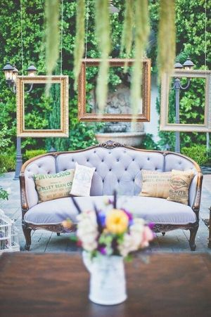 Engagement decor with sofa and hanging frames