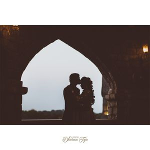 A groom kissing her bride on the forehead during an outdoor pre-wedding shoot.