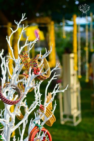 Bangles on painted branches for mehndi decor
