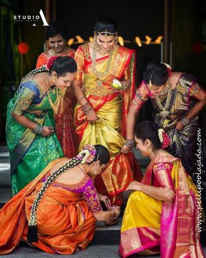 South indian bride with her sisters on her wedding day