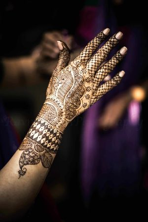 Modern bridal mehendi on back of hand