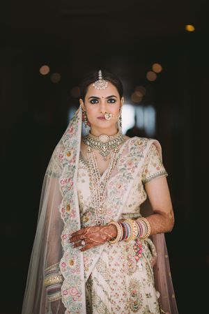 Offbeat bridal lehenga in ivory with silver jewellery