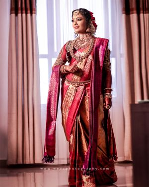A south indian bride in red kanjeevaram and temple jewellery