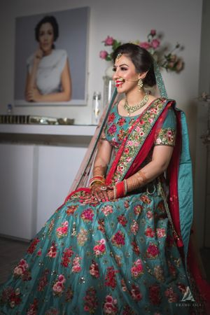 Bridal lehenga in red and teal with floral embroidery