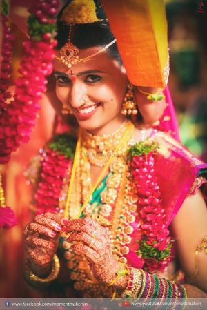 A south indian bride in a kanjeevaram and temple jewellery