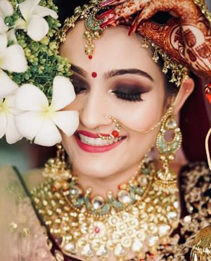 Bridal makeup with plum and brown smokey eyes