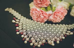 Pretty diamond jewelry with red beads