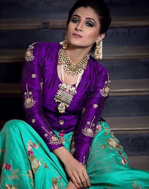 Pretty purple blouse with turquoise lehenga with jewellery