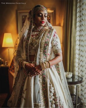Floral embroidery bridal lehenga with white tassels