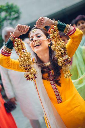 Happy bride showing off kaleere