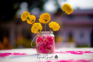 Floral centrepiece with marigolds and rose petals