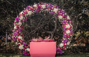 Giant floral wreath as mehendi or engagement photobooth