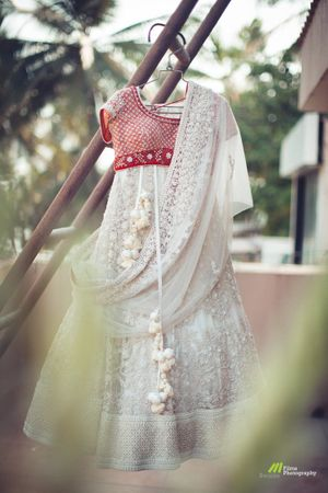 Offbeat bridal lehenga in white with contrasting red blouse