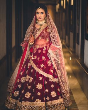 Marsala and gold bridal lehenga