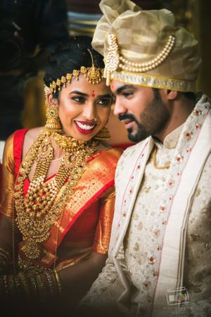 A south Indian bride wearing heavy temple jewelry
