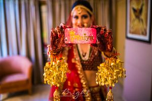 Bride holding dulhaniya phone cover on wedding
