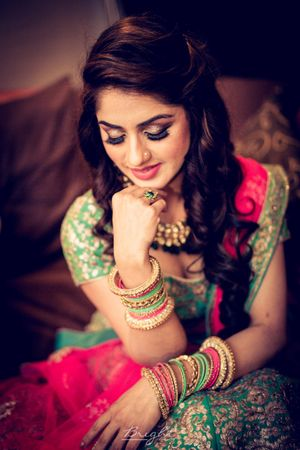 Engagement bridal look with green and pink lehenga