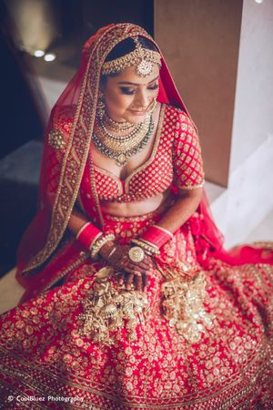 Bride in red and gold lehenga
