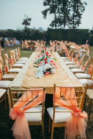 Backyard wedding decor with gold and peach theme