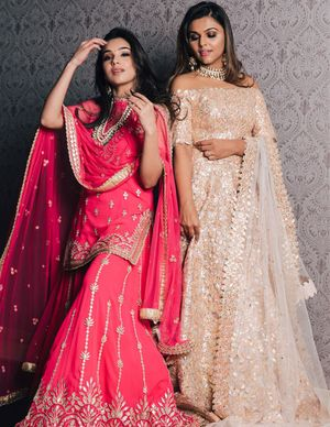 Off-shoulder gold engagement gown and pink sharara