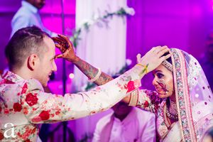 Photo of Beautiful candid couple shot while doing wedding rituals