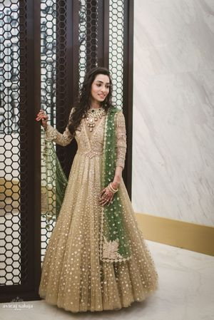 Gold anarkali with green dupatta