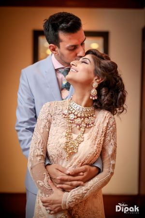 Peach gown with layered necklace on engagement