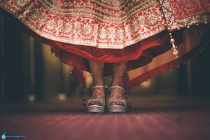 Silver bridal shoes with red lehenga