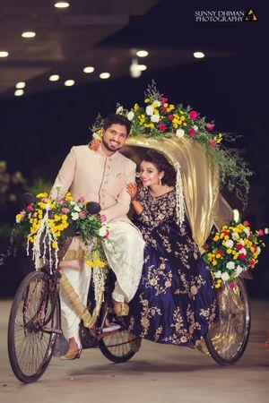 Photo of Couple posing on rikshaw on engagement day
