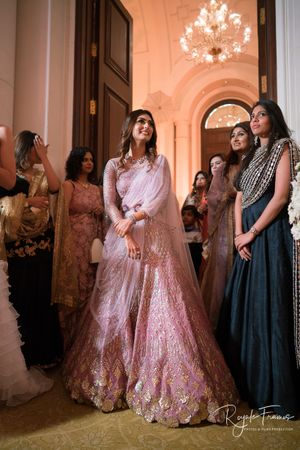 Light pink lehenga for roka with attached dupatta