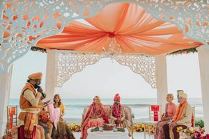 Beachside mandap with white and peach decor
