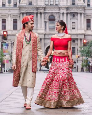 Red bridal lehenga with off shoulder blouse and no dupatta