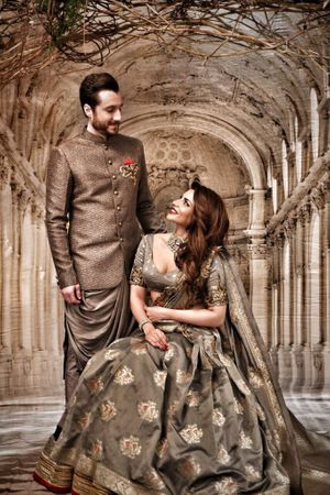 Dark grey outfits for bride and groom engagement and sangeet