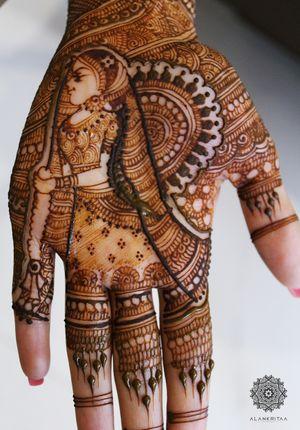 Unique mehendi design with bride holding jaimala