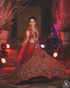 Beautiful red and gold bridal lehenga with long rani haar