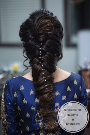 Unique braid with pearls in hair