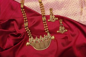 Beautiful temple jewellery set with unique design in gold